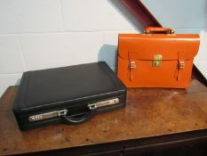 A leather attache case and satchel