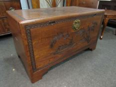 A mid 20th Century Southeast Asia camphor wood trunk with carved decoration and sliding tray (with