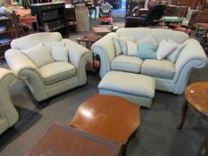 A suite comprising of two sofas, two armchairs and a footstool,