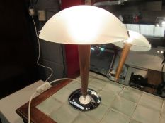 A modern Swedish table lamp with beech and chrome effect base,