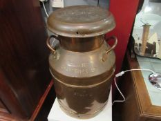 A copper 5 gallon twin handle Trowbridge Creameries lidded milk churn