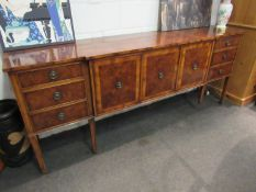 A modern burr wood sideboard, three cupboard doors flanked by six drawers, leg a/f, 214cm long,