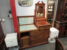 "In the manner of ""Maple & Co"" a late Victorian walnut combination washstand dressing chest,"