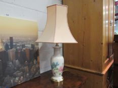 A decorative table lamp with shade