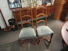 A 19th Century set of six French fruitwood ladder-back dining chairs on turned legs joined by an