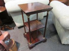 A Georgian style mahogany three tier lamp table the brass corinthian top mahogany supports over