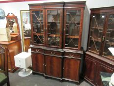 An astragal glazed top over three drawer three door cupboard base bookcase,