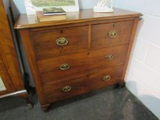 Circa 1860 chest of two short over two long drawers with turned bun handles and feet,