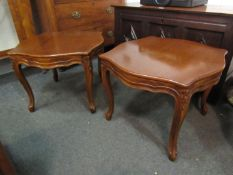 A pair of French style serpentine top lamp tables on carved cabriole legs,