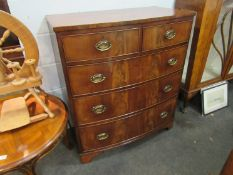 A circa 1840 flame mahogany bow front chest of two short over three drawers,