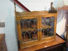An Old Charm oak astragal glazed two door wall mounted cabinet