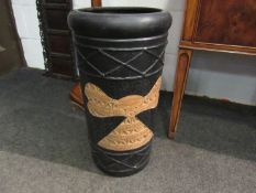 A cylindrical craft pottery stick stand with fish and Aztec design,