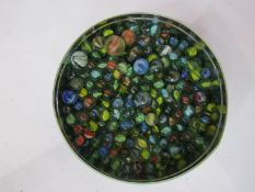 A tin of mixed marbles