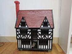 A hand built Tudor style dolls house, approx.