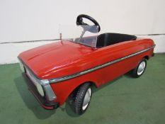 A child's Moskvitch pedal car,