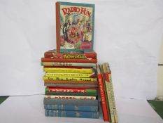 A box of mixed books and annuals including 'The Holiday Book',