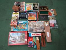 A large collection of mixed games and puzzles including Lexcon, dominoes, cribbage, Rummikub,