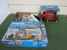 A boxed Sylvanian Families Country Bus and a Playmobil City Action set