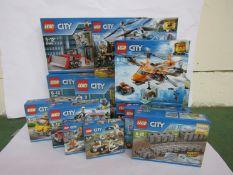 Twelve unopened Lego City sets; 60137, 60193, 7499, 60221, 60084, 60077, 60171, 60150, 60169 (x2),