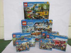 Eight unopened Lego City sets; 60167, 60160, 60158, 7499, 60088, 60077,