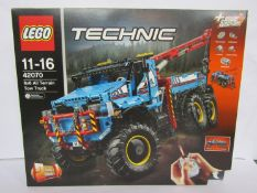 A boxed Lego Technic set 42070 6x6 All Terrain Tow Truck