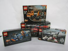 Four unopened Lego Technic sets; 42057 Ultralight Helicopter , 42071 Dozer Compactor,