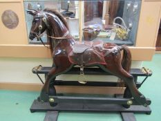 A brown gloss painted rocking horse on trestle rocker, horse hair mane,