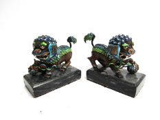 A pair of miniature dogs of fo figures with bright enamel detail,