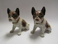 A pair of early 20th Century porcelain Pug dog figures,