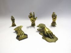 Five various brass hands including note holders