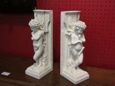 "A pair of art form ""Little Thinker"" bookends,"