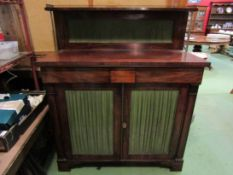 A circa 1800 mahogany chiffonier the three quarter pierced brass gallery and raised shelf on reeded