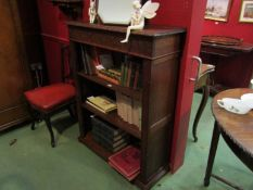 A circa 1900 oak freestanding bookshelf with height adjustable shelves and carved decoration,
