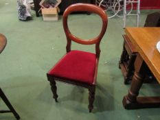 A set of six Victorian mahogany balloon back dining chairs on turned and tapering legs