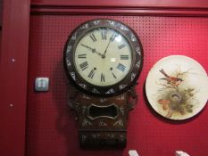 A 19th Century mother-of-pearl inlaid drop dial wall clock, some veneer missing,
