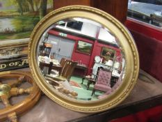 A gilt oval wall mirror,