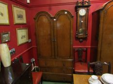 A 20th Century Butilux Queen Anne style two door wardrobe on three drawer base,