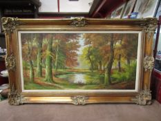 An oil on canvas of Autumnal woodland scene, classical gilt frame, signed lower right,