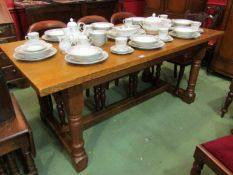 A medium oak 17th Century style refectory dining table on turned legs joined by an H stretcher.