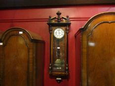 A Vienna wall clock with pendulum and weight,