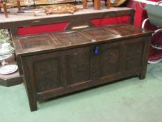 A 17th Century panelled oak coffer (with key) carved floral panels to front. Candle box to interior.