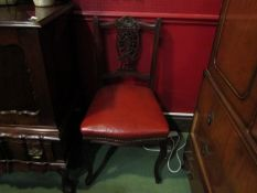 A set of four Victorian dining chairs with pierced splats and leatherette seats