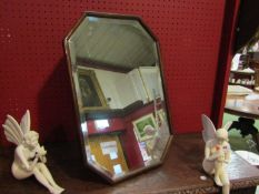 A bevel edged canted corner easel back/wall hanging mirror,