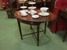 An Edwardian Pembroke table with carved border/edge, square tapering legs, filled cracks to top,