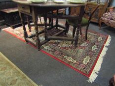 A red ground rug, central square medallion, mulitple borders,