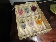 A boxed set of six 1945 coloured sherry glasses