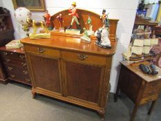 A French oak and walnut dresser base with upstand and key,