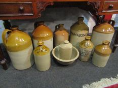 Eight stone ware jars and flagons,