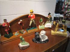 A collection of pub brewery and cigarette advertising figures including Dewars, Johnnie Walker,