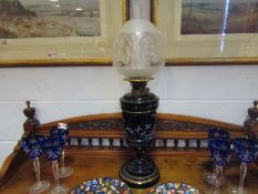 A Bristol blue glass oil lamp with bird decoration